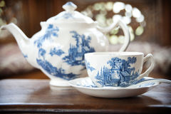 Porcelain teapot. A porcelain teapot and cup with saucer Royalty Free Stock Photography