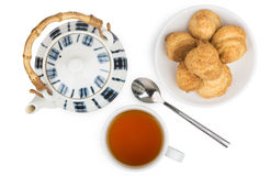 Porcelain teapot, cup of tea and biscuits on  saucer Royalty Free Stock Photo