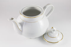 Porcelain teapot with gold border Royalty Free Stock Images