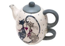 Porcelain teapot with a mug in the original version with image of cats Royalty Free Stock Images