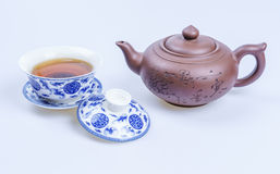 Porcelain teapot and teacup on white background Royalty Free Stock Photo