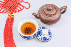 Porcelain teapot and teacup on white background Royalty Free Stock Photography