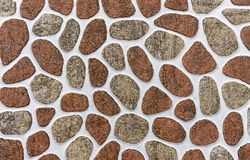 Porcelain tile with a pattern of stones of different shapes and sizes. Background of stones royalty free stock photography