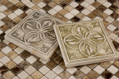 Porcelain tile and travertine mosaic. Combination of square porcelain tiles and travertine and marble mosaics royalty free stock image