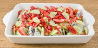 Porcelain Tray with Delicious Fresh Fruits Salad Stock Photos