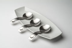 Porcelain tray with steel spoons for tapas Stock Images