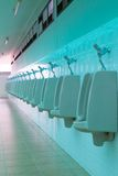 Porcelain urinals in public toilets Royalty Free Stock Photos