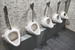 Porcelain urinals Stock Photo