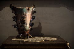 Porcelain vase in old photo. Photo of a porcelain vase with flowers under the light of sun stock images