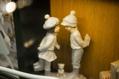 Porcelain white figures of a boy and a girl. Porcelain white figures of a boy and girl Royalty Free Stock Image