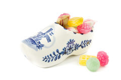 Porcelain wooden shoe souvenir filled with old Dutch sweets Stock Photo