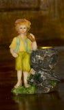 Porcelan figurek chłopiec świeczki właściciel Zdjęcia Stock