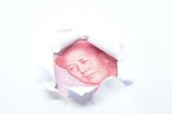 Porcelanowa waluta przez poszarpanego białego papieru Obrazy Stock