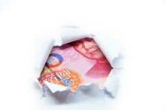 Porcelanowa waluta przez poszarpanego białego papieru Zdjęcia Stock