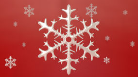 Porcelin snowflake with red background Stock Photography