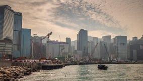 Porcellana di lasso di tempo di panorama 4k della costruzione della baia del kongscape di hong di tramonto stock footage