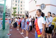 Porcellana di Shenzhen: allievi per condurre le attività Fotografia Stock