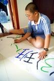 Porcellana di Shenzhen: studenti della scuola secondaria primaria e nella scrittura Fotografia Stock