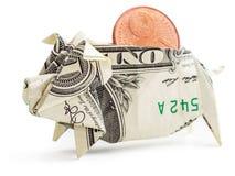Porcellino salvadanaio di origami del dollaro isolato Fotografia Stock
