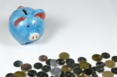 Porcellino salvadanaio monete Fotografie Stock Libere da Diritti
