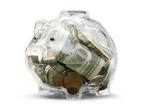 Porcellino salvadanaio trasparente con le monete e le banconote Immagine Stock Libera da Diritti