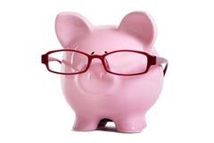 Porcellino salvadanaio, vetri, vecchiaia, saggezza, concetto di risparmio di pensionamento Fotografia Stock Libera da Diritti