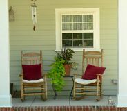 Porch 1A. Beautifully decorated front porch with plants and rocking chair Royalty Free Stock Photography