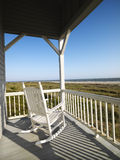 Porch at beach. Rocking chair on porch with railing overlooking beach at Bald Head Island, North Carolina Stock Image