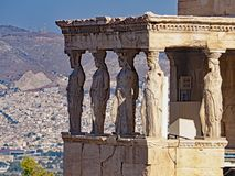 The Porch of the Caryatids, Athens, Greece. The Porch of the Caryatids on the Acropolis with the city of Athens, Greece in the background royalty free stock photo