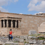 Porch of caryatids. ATHENS, GREECE - MAY 6, 2014: Woman in front of the Porch of Caryatids. Erechtheion ancient temple ruins at the Acropolis of Athens, Greece Stock Photography