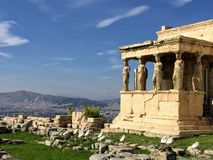 Porch of the Caryatids. The Erechtheion or Erechtheum is an ancient Greek temple on the north side of the Acropolis of Athens in Greece which was dedicated to royalty free stock photography
