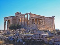 The porch of the Caryatids and the Erecthion at the Acropolis in Athens, Greece. A view of the porch of the Caryatids and the Erecthion at the Acropolis in royalty free stock image