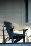 Porch chair. Wooden chair on a sunlit porch of a house Stock Images