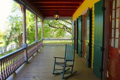 Porch Chair. A rocking chair sits on a southern creole veranda in Louisiana Stock Images