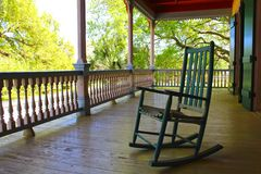 Porch Chair. A rocking chair sits on a southern creole veranda in Louisiana Royalty Free Stock Images