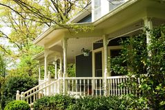 Porch Details/Victorian House. Porch area close up of a Victorian home nestled among the trees Stock Photography