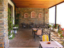 Outdoor cafe in Greece Stock Images