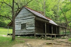 Historic Log Cabin in the Smokey Mountains. Porch extends the length of this old Log Cabin in the Mountains Stock Images