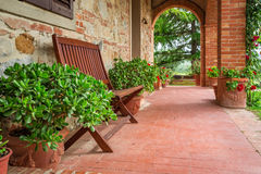 Porch full of flowers in Tuscany Royalty Free Stock Photo