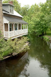 Porch on the Rideau Canal, Perth Ontario Canada. The water below this old stone waterfront building supplies the historic, and still operating, Rideau Canal lock stock image