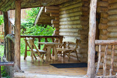 Porch of a house in the woods. On the porch of a wooden table and two benches. Park Hotel, Russia, Ulyanovsk stock photos