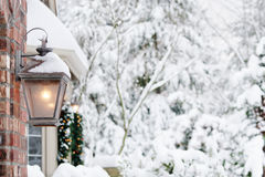 Porch light on snowy day Royalty Free Stock Images