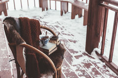 Porch of log cabine with snow Stock Image