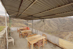 Porch With Majestic Scenery. Cafe on porch with majestic mountain scenery Royalty Free Stock Images