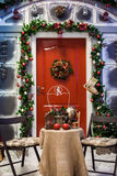 Porch with red door with Christmas wreath stock image