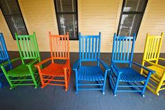 Porch Rockers. Brightly colored rocking chairs on a hotel porch in Upstate NY Royalty Free Stock Images