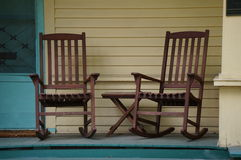 Porch rocking chairs. Two rocking chairs sit waiting for their next visitors Royalty Free Stock Image