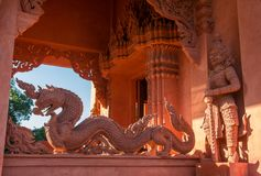 Porch with stone dragons of Red Temple - Wat Ratchathammaram on Koh Samui island royalty free stock photography