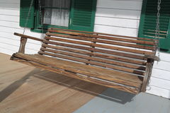 Porch Swing. Wood Porch Swing in sunny day Stock Photography