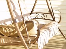 Porch Swing. A white decorative porch swing royalty free stock photo